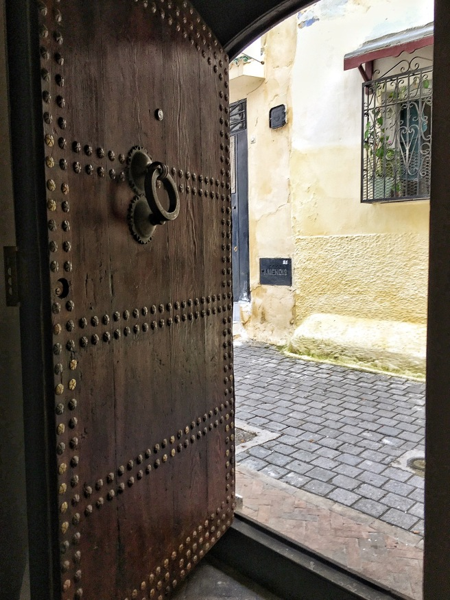 Beautiful wooden door leading to the entrance of the riad